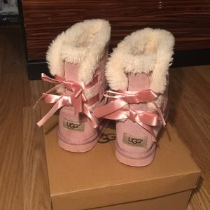 UGG Shoes - Pink girls Ugg boots with bows, worn